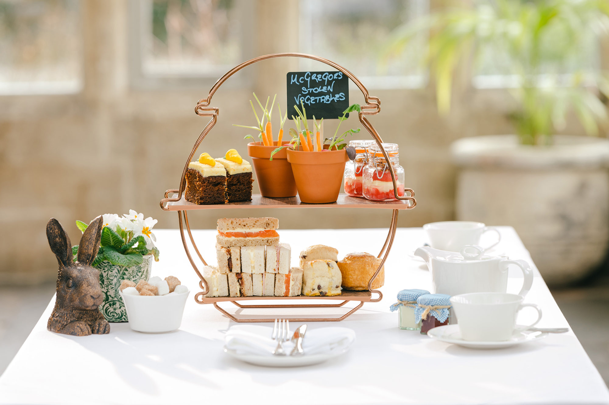 Afternoon tea for kids and adults on a white table at a Luxury Family Hotel.